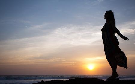 beautiful girl relaxes on background of ocean, bali, indonesia Standard-Bild