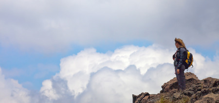 mayon: woman tourist standing on a volcano in Indonesia, Bali at clouds Stock Photo