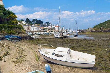 Picture of boats, standing at low tide on the coast of the island Belle Ile en Mer. France.