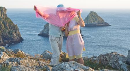 bretagne: Kissing couple at honeymoon in Bretagne, France Stock Photo