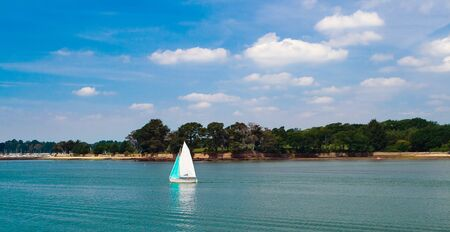 Picture of boat, sailing at the sea near the coast of the golfe de Morbihan. France. Imagens