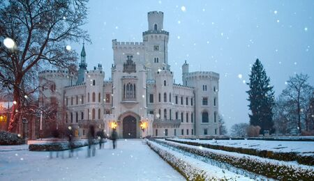 nad: Castle of Hluboka nad Vltavoy at winter. Czech republic. Motion blurred people (tourist)
