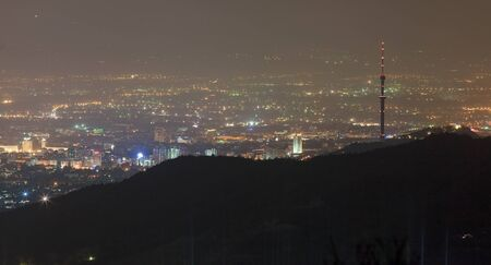 tv tower: Image top night lighting of the city of Almaty, in the foreground which depicts the silhouette of the famous hill of the Kok-Tobe with the TV tower. Kazakhstan.