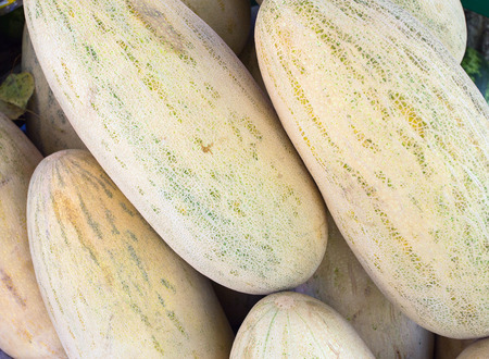 imposed: Image of a large number of melons imposed in the form of a pyramid on the market.