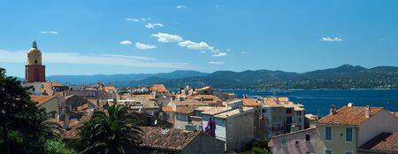 sublime: Image made with a sublime place of St Tropez, where the red roofs of the houses and the azure shore away from the horizon of the mountains.