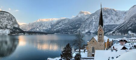 christmas eve: Image of cold and snowy winter in Austria. Beautiful mountain and nature at Hallstatt near Obertraun city opposite the Hallstatter See lake at foggy wather. On Christmas eve. Stock Photo