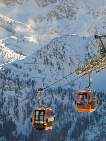 climbing cable: Snowboard and Ski Extreeme sport on the European Alps. Above beautiful sky on the snowy mountain.
