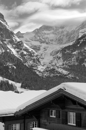 eiger: Hotel near the Grindelwald ski area on the mountain. Switzerland. View between of the mountain Schreckhorn and Eiger. Black and white