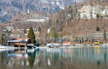 interlaken: Alps near the lake in Interlaken. In the foreground a beautiful reflection with an emerald hue, Interlaken, Switzerland