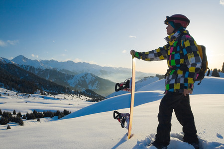 freeride: An image with snowboarder with a helmet and glasses on the background of high snow-mountain Alps in Grindelwald, Swiss