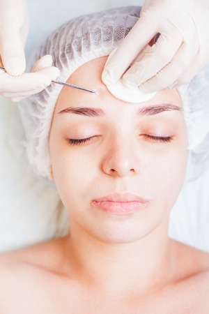 rejuvenation: Cosmetologist at spa beauty salon doing acne treatment using mechanical instrument. Concept of medical treatment of rejuvenation and skincare