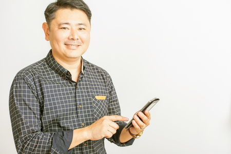 utility payments: unrecognizable person of asian businessman using a tablet pc at white background for any text. Its can be used for business and wireless technology, internet or utility payments