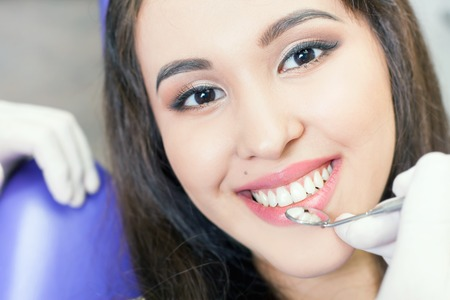 Beautiful asian woman smile with healthy teeth whitening. Dental care concept. Stock Photo