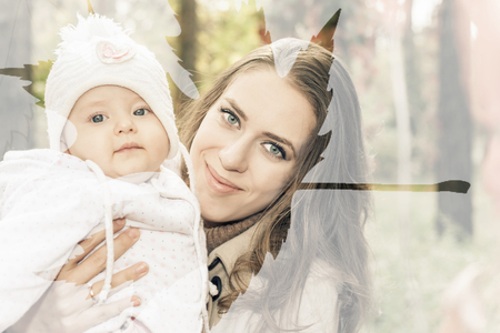 mothercare: Image with multiexposition effect of happy mother with her baby outdoor and maple leaf at autumn park. They wearing a coat, hat, baby jacket and looking at camera. Stock Photo