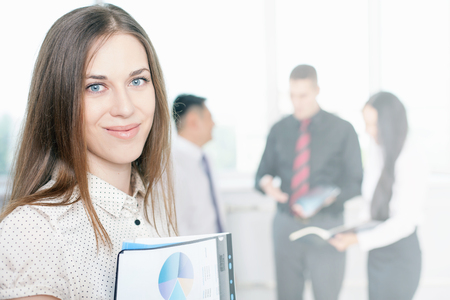 achieve: Successful businesswoman and business team of men and woman at background. Successful corporation or company where achieve success for intelligent people