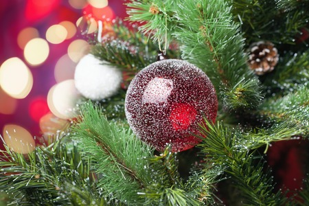 red christmas ball: Image of decorated red ball on Christmas tree with blurred and sparkling bokeh at abstract background Stock Photo