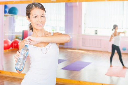 botle: Happy asian woman after fitness exercise holding natural water at plastic botle. Eating, sport and healthy lifestyle concept