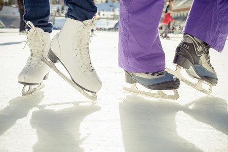 Closeup skating shoes ice skating outdoor at ice rink. Healthy lifestyle and winter sport concept at sports stadium Stockfoto
