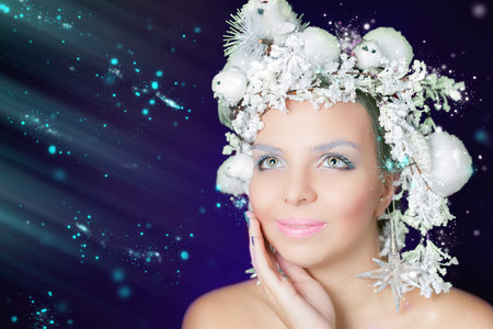 hairstyle: Winter Queen with white magical hairstyle. Beauty Christmas makeup. Xmas woman. Sales and shopping concept at holiday Stock Photo