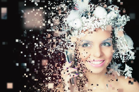 Winter Queen with white magical hairstyle using mobile phone. Christmas Makeup. Xmas woman. Photoshop, art effect of pixelated decomposition.