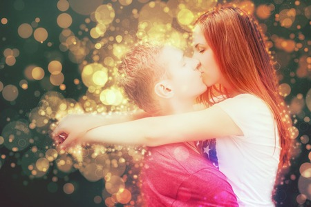 Happy Valentines Day couple kissing, 14th February celebration, Valentine. Love concept. Heart symbol background.
