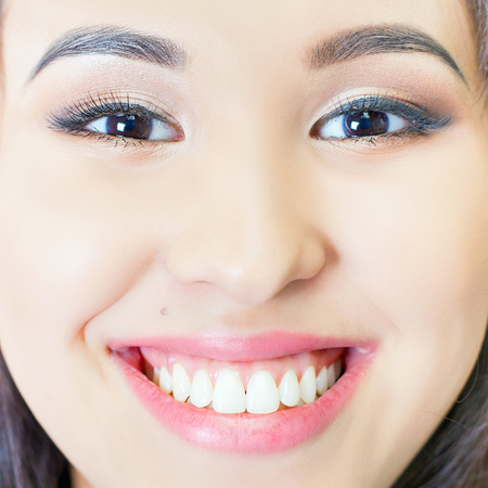 implants: Beautiful asian woman smile with healthy teeth whitening. Dental care concept. Implants. White and healthy smile. Closeup