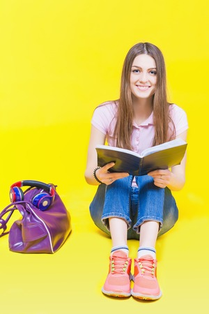 smart girl: Pretty teenage girl preparation for exams and test. Education. Fashion student. Institute. Shopping. Bag. Color Stock Photo