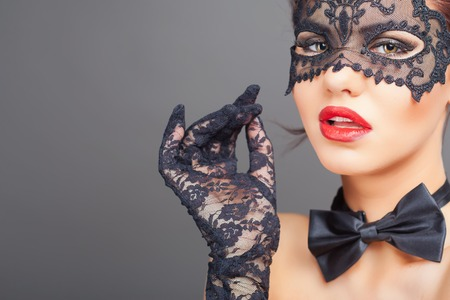 Sexy woman with carnival mask. Fashion. Venetian carnival. Sex shop. Hot babe. Party. Night background Standard-Bild