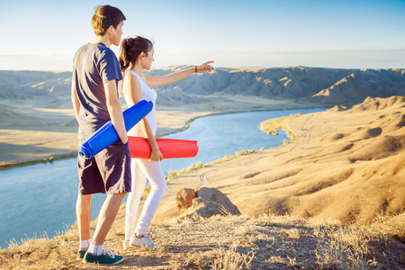 soul: Happy asian couple with yoga mat. Thay going to play in sports or fitness exercises outdoor at mountain. Healthy lifestyles concept of body and soul Stock Photo