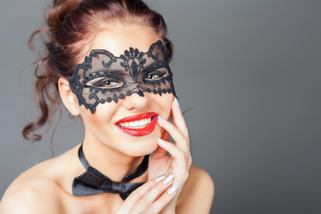 sex symbol: Sexy happy woman with carnival mask. Fashion. Venetian carnival. Sex shop. Hot babe. Party. Night background