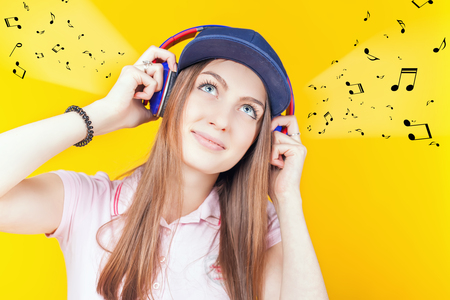 hz: Happy teenager girl uses a headphones. Fashion student. Shopping. Listen to music. No cord