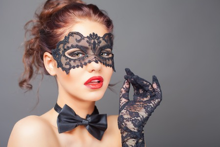 Sexy woman with carnival mask. Fashion. Venetian carnival. Sex shop. Hot babe. Party. Night background Stock Photo
