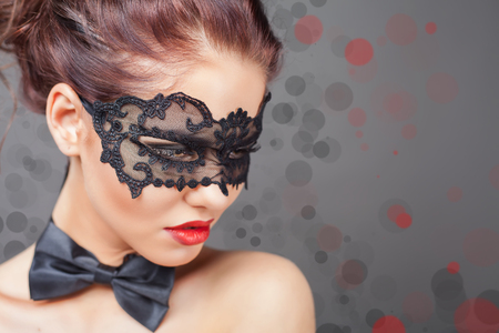 animal sex: Sexy woman with carnival mask. Fashion. Venetian carnival. Sex shop. Hot babe. Party. Night background Stock Photo