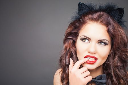 sex shop: Sexy woman with cat carnival mask. Ears. Role-playing games. Games for Adults. Fashion. Venetian carnival. Sex shop. Hot babe. Party. Night background Stock Photo