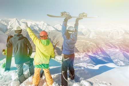 Inspired group of snowboarders at summit. Winter sports. Switzerland, alps. Snowboard.