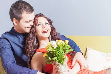 ladies day: Beautiful happy woman received a flower bouquet of chinese roses. Boyfriend gave flowers.