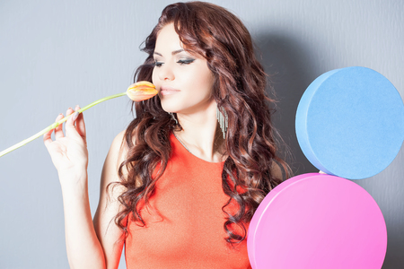 womens day: World Womens Day. Beautiful happy woman received a tulip flower. Stock Photo