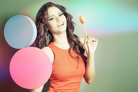 womens day: World Womens Day. Beautiful happy woman received a tulip flower. Valentines Day, 8 March Stock Photo