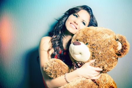 women  s fashion: Happy woman received a teddy bear. Stock Photo