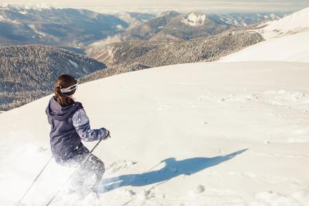 deep powder snow: Skier woman riding by powder deep snow. Swiss mountain