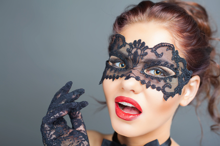sex shop: Closeup sexy surprised woman with carnival mask. Fashion. Venetian carnival. Sex shop. Hot babe. Party. Night background Stock Photo