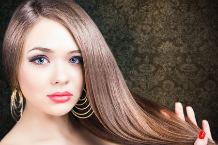 Fashion hairstyle. Beautiful woman with long straight hair. Barbershop. Healthy shampoo. Volume. Beauty. Hair keratin straightening, coloring