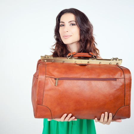dimensions: Surprised woman holding hand luggage at airport terminal. Size. Restrictions. Vacation rentals, packages. Suitcase sale. Tourist bag. Passenger. Airlines. Weight, baggage dimensions. Baggage allowance