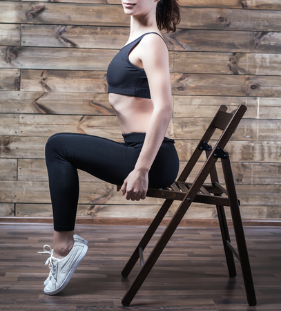 Workout exercises at home to lose weight. Woman training. Good body. Pilates. Vintage 版權商用圖片