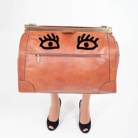 allowance: Funny luggage with womans legs. Hand luggage. Lost baggage at airport terminal. Leather suitcase sale. Tourism. Vintage tourist bag. Passenger. Airlines. Weight, baggage dimensions. Allowance. Loss. Stock Photo
