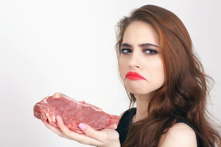 expiration date: Image of woman holding packaged meat at the supermarket. Healthy eating. Meat recipes, expiration date, shelf life Stock Photo