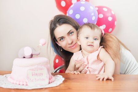 wish desire: Mother with funny baby celebrating first birthday. Cake is surprise for child. Make a first wish. Desire Stock Photo
