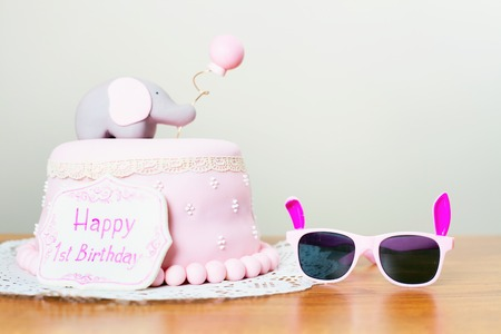 mothercare: Celebrating first birthday. Cake and sunglasses. Happy 1st birsday, one year. Surprise for child. Make a first wish. Desire.