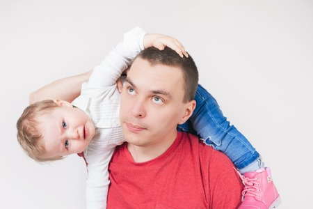 paternal: Unhappy father with child. Stress. Baby. Sad daddy. Family problems. Paternal care very important for kid. Custody. Rights