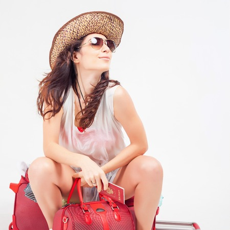 lugage: Flight delay. Happy woman with luggage waiting plane, airline at airport terminal. Suitcase. Traveler girl holding russian passport. Tourism. Tourist bag. Departure